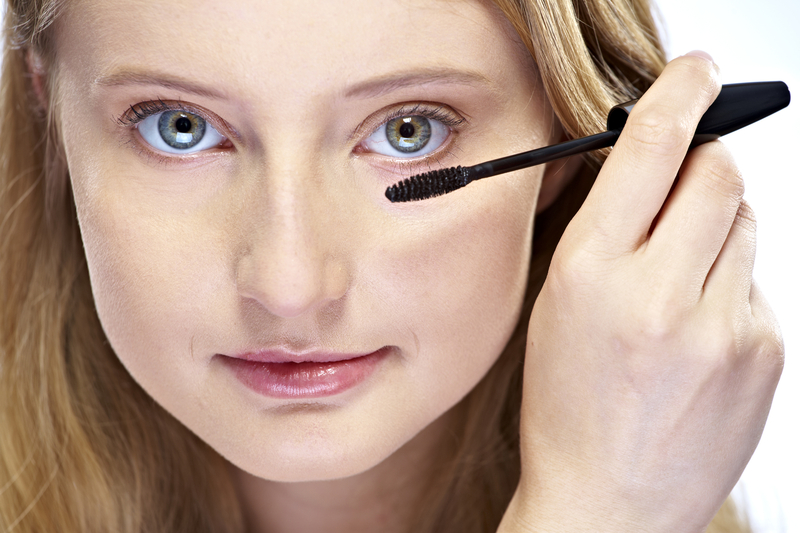 http://www.dreamstime.com/royalty-free-stock-photography-woman-putting-mascara-makeup-image25258567