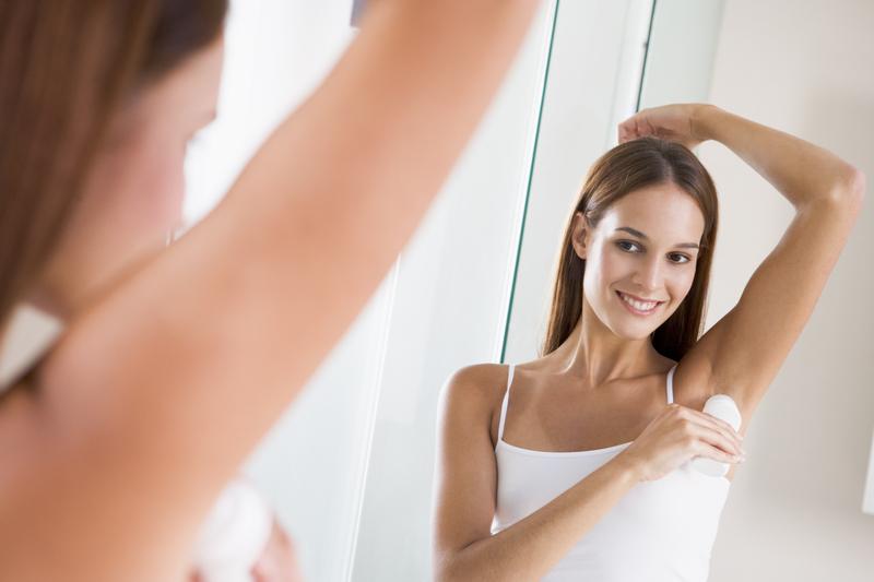 http://www.dreamstime.com/stock-photography-woman-bathroom-applying-deodorant-image5930232