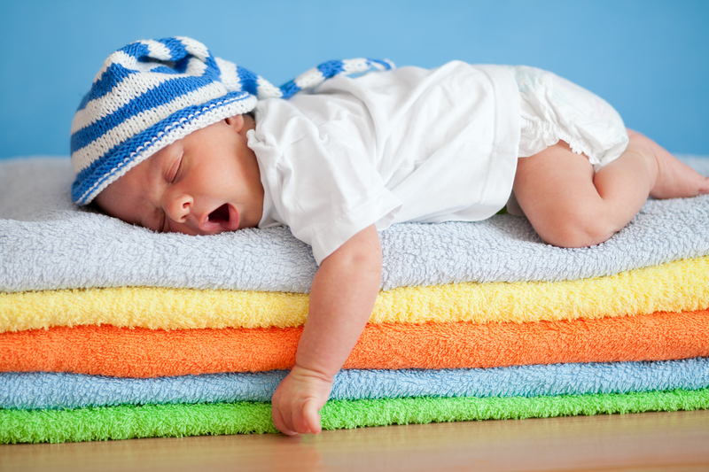 http://www.dreamstime.com/royalty-free-stock-photos-yawning-sleeping-baby-colorful-towels-stack-image23740308