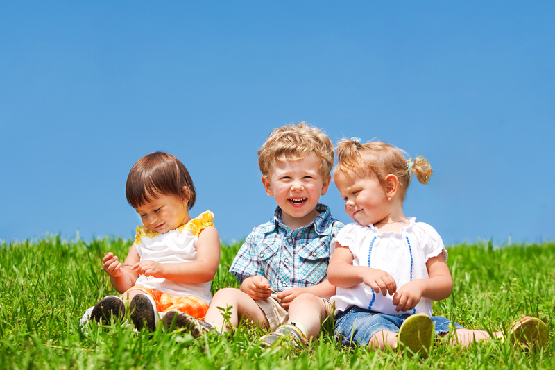 http://www.dreamstime.com/royalty-free-stock-photography-kids-sit-grass-image23812807