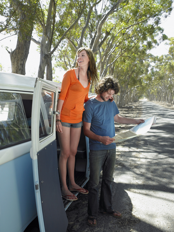 http://www.dreamstime.com/stock-photo-couple-reading-map-road-trip-full-length-happy-young-women-standing-campervan-door-men-looking-image33910950