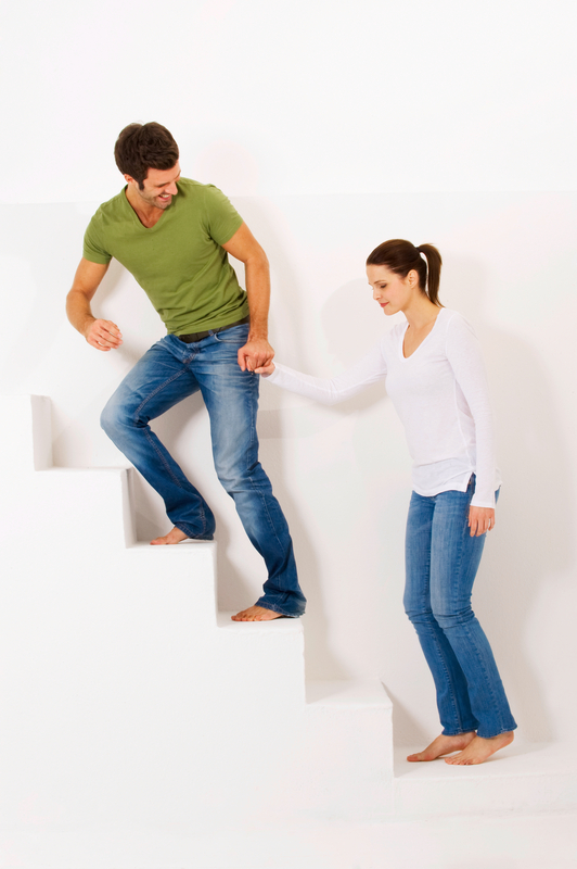 http://www.dreamstime.com/royalty-free-stock-images-couple-up-stairs-holding-hands-image22361849