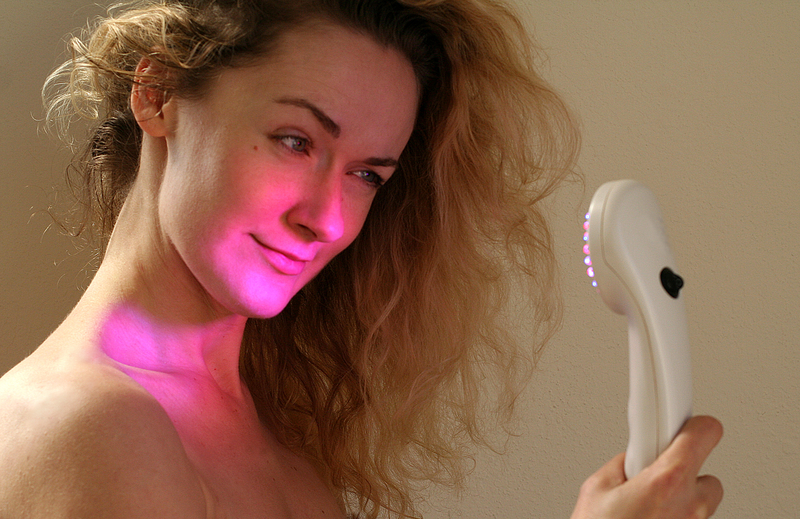 http://www.dreamstime.com/royalty-free-stock-image-light-therapy-young-woman-holding-led-device-acne-wrinkles-prevention-image35740746