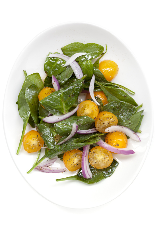 http://www.dreamstime.com/stock-photography-spinach-tomato-salad-yellow-white-plate-overhead-view-isolated-image38542002