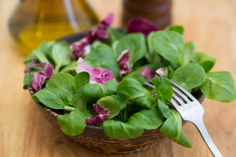 http://www.dreamstime.com/stock-photo-wooden-bowl-corn-salad-leaves-radicchio-background-image41990570