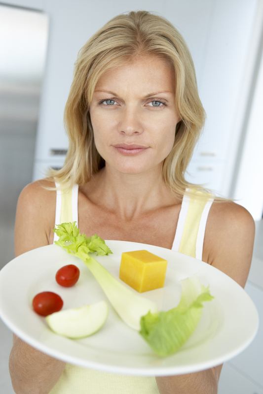 http://www.dreamstime.com/royalty-free-stock-photography-mid-adult-woman-holding-plate-healthy-food-image7873467