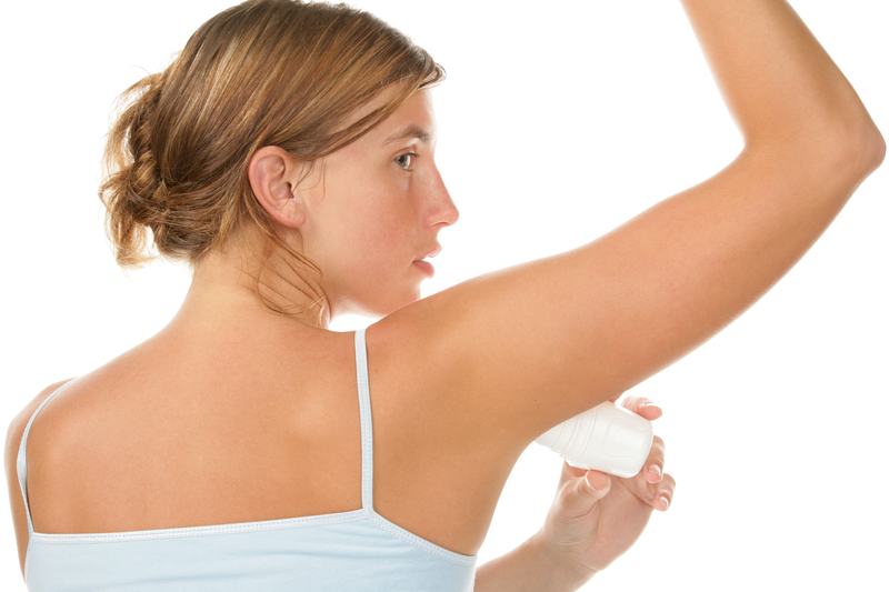 http://www.dreamstime.com/royalty-free-stock-photo-woman-using-deodorant-image11240795