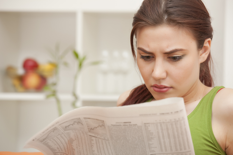 http://www.dreamstime.com/royalty-free-stock-image-woman-reading-bad-news-newspaper-image19976426