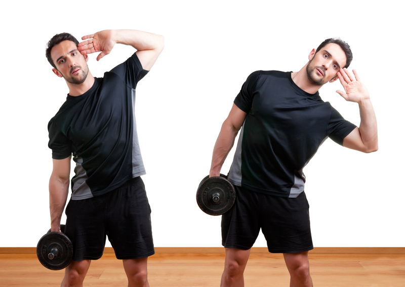 http://www.dreamstime.com/stock-photography-dumbbell-side-bend-personal-trainer-doing-bends-training-his-abs-gym-image31865002