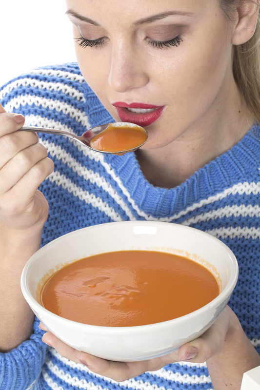 http://www.dreamstime.com/stock-images-attractive-young-woman-eating-tomato-soup-model-released-image34070704