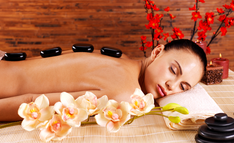 http://www.dreamstime.com/royalty-free-stock-photo-adult-woman-relaxing-spa-salon-hot-stones-back-beauty-treatment-therapy-image34563335