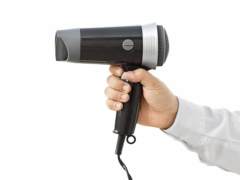 http://www.dreamstime.com/stock-images-hair-dryer-business-man-holding-image34675144