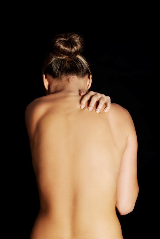 http://www.dreamstime.com/stock-photography-nude-topless-woman-scratching-her-neck-back-view-black-background-image35655522
