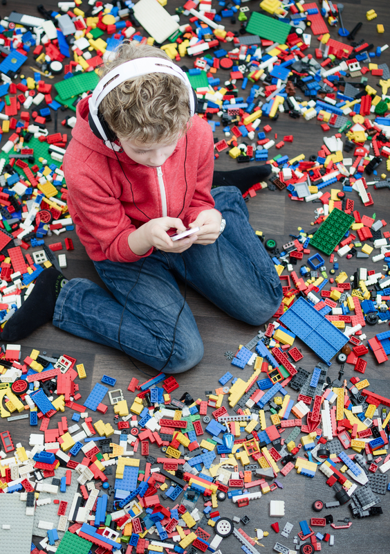 http://www.dreamstime.com/stock-photo-spoiled-kid-child-boy-to-many-toys-using-smartphone-to-play-image36179920