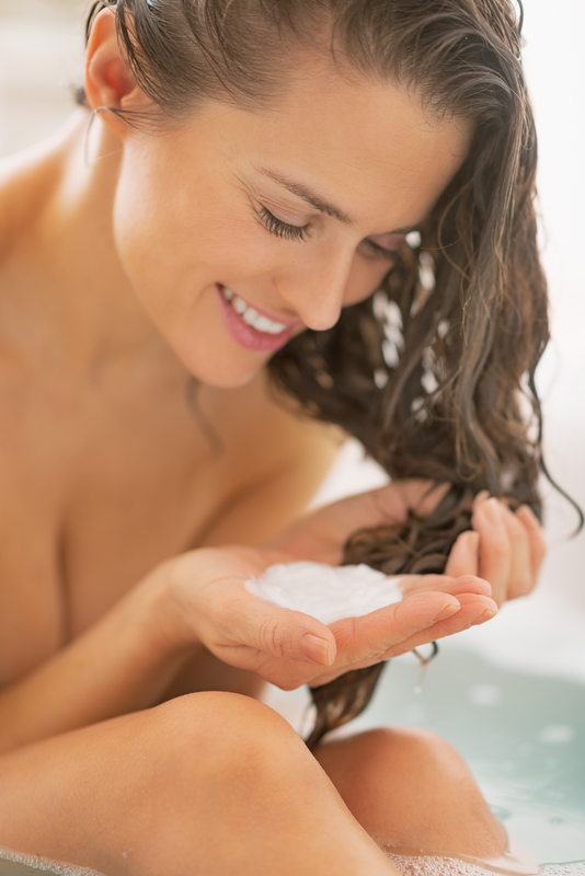 http://www.dreamstime.com/stock-images-happy-young-woman-applying-hair-conditioner-bathtub-white-image36368364