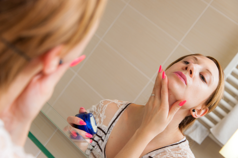 http://www.dreamstime.com/royalty-free-stock-photography-woman-applying-cream-face-young-beautiful-night-her-bathroom-image36863387