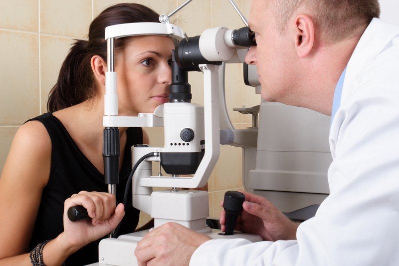 http://www.dreamstime.com/stock-image-male-ophthalmologist-conducting-eye-examination-image985221