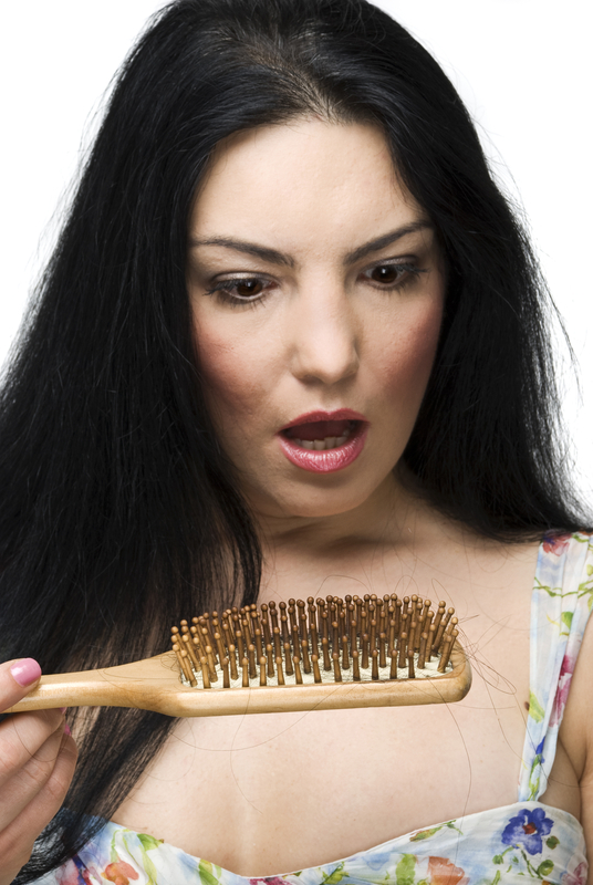 http://www.dreamstime.com/stock-image-shocked-woman-loss-hair-hairbrush-image12697021