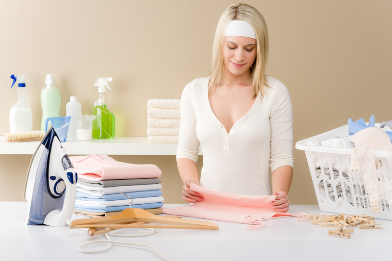 http://www.dreamstime.com/stock-image-laundry-ironing-woman-folding-clothes-image18723841