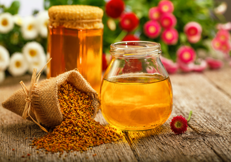 http://www.dreamstime.com/royalty-free-stock-photography-honey-still-life-jars-pollen-flowers-image31477357