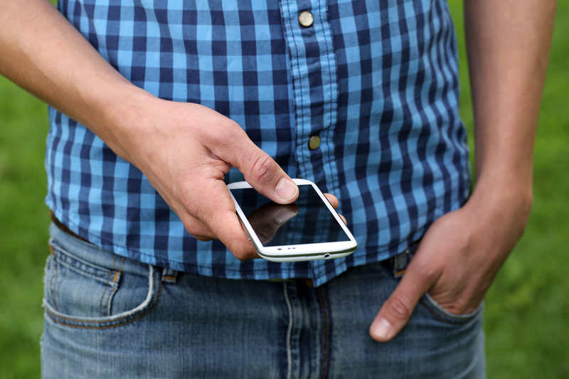http://www.dreamstime.com/royalty-free-stock-images-young-man-using-smartphone-tipping-his-fingers-image33526179