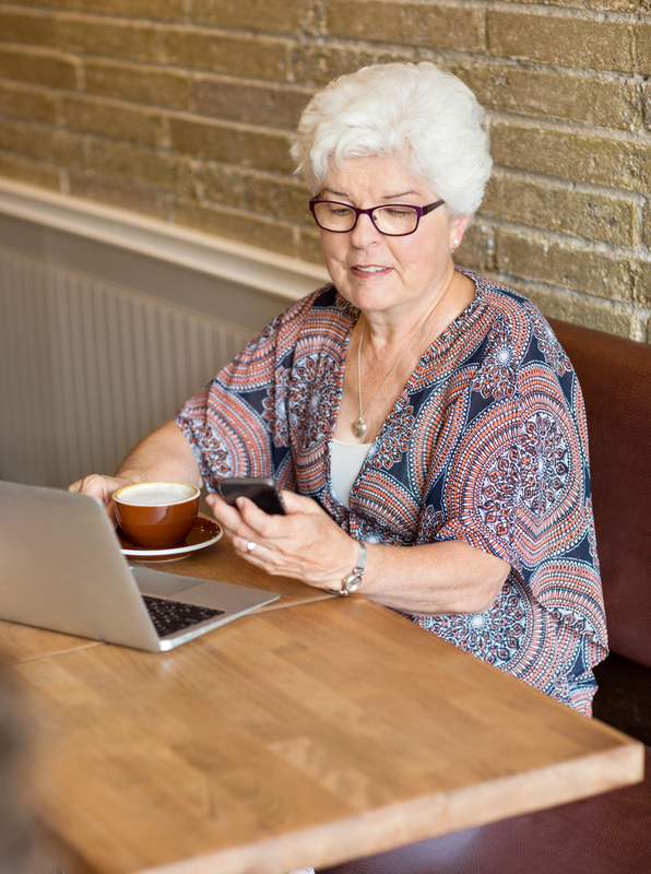 http://www.dreamstime.com/royalty-free-stock-image-woman-text-messaging-smartphone-cafe-senior-laptop-coffee-cup-image35691096