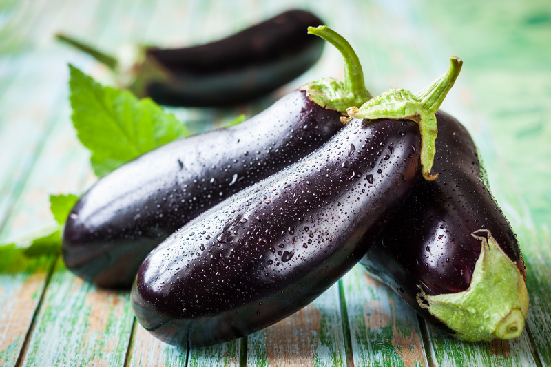 http://www.dreamstime.com/stock-images-eggplant-fresh-old-wooden-table-image42209454