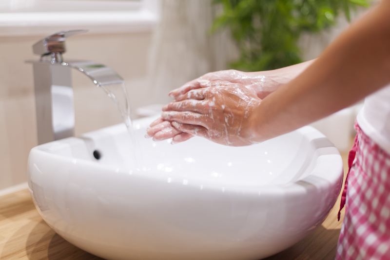 http://www.dreamstime.com/royalty-free-stock-images-washing-hands-close-up-woman-bathroom-image43077519