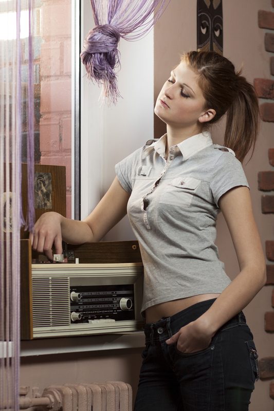http://www.dreamstime.com/stock-images-beautiful-young-woman-listening-to-music-image28906484